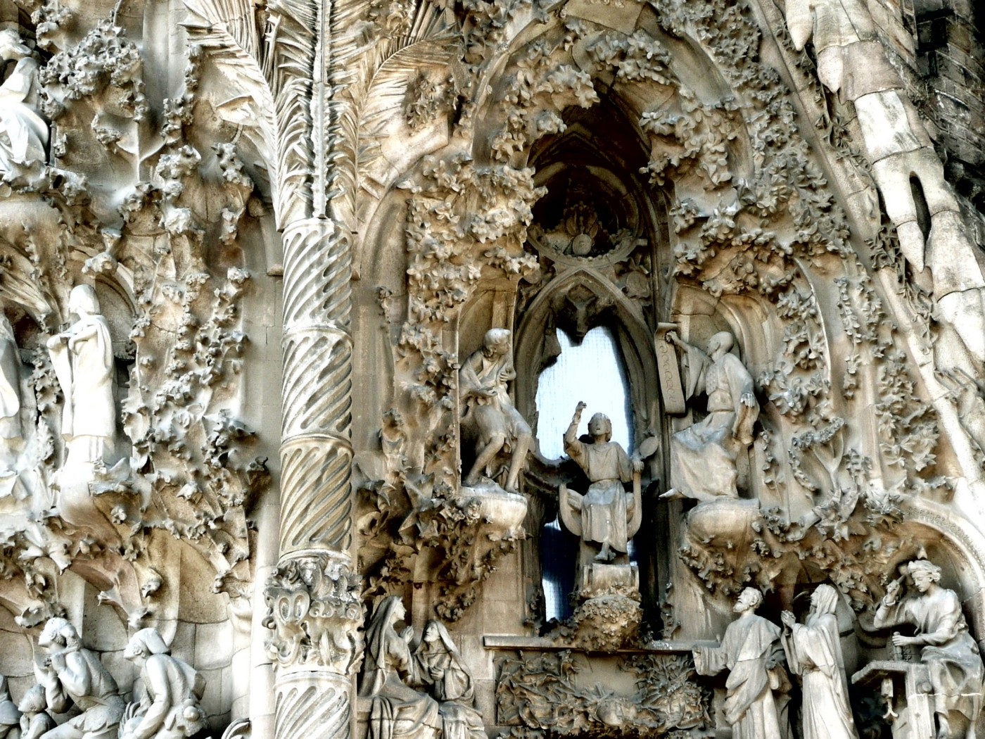 A photo of intricate carved structures on the outside of the Sagrada Família.