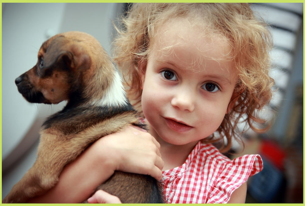picture of a little girl and her puppy