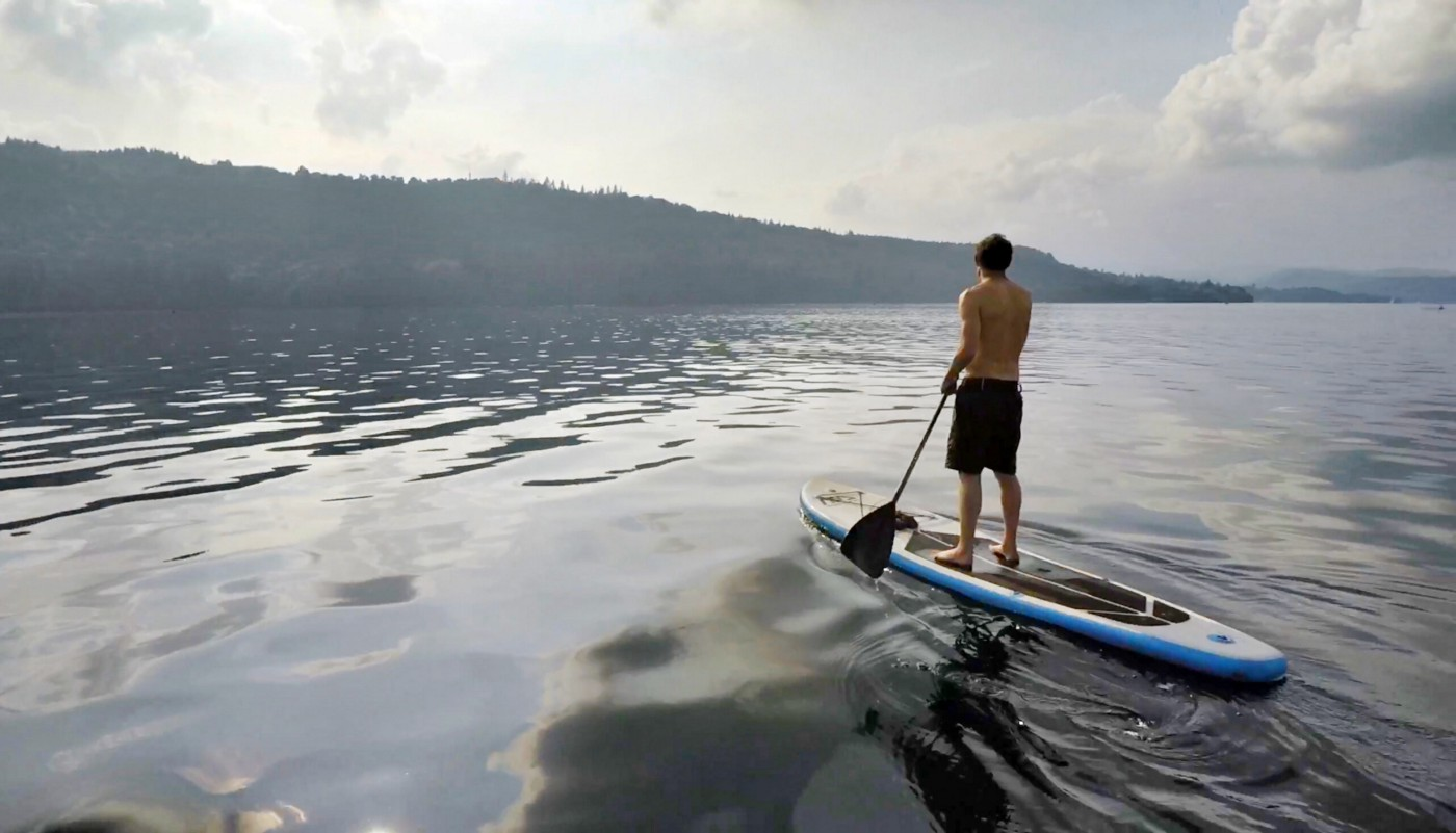 A paddle boarder on a lake