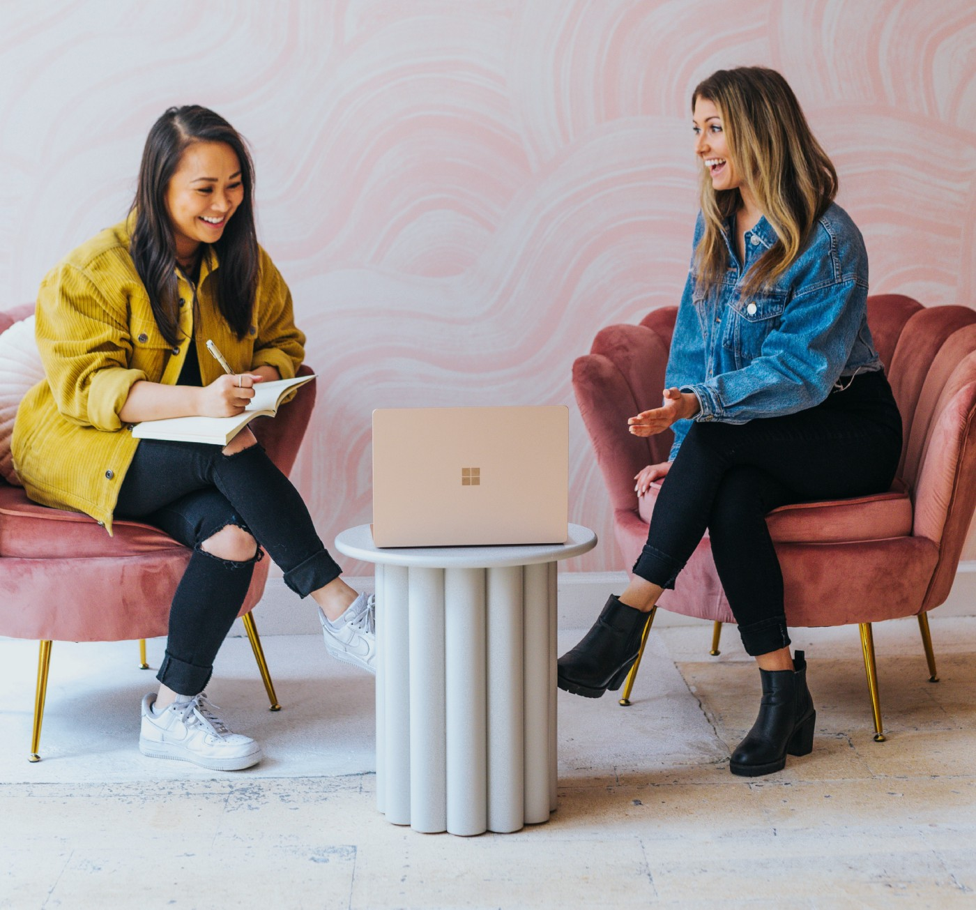 Two women in a meeting looking at a laptop