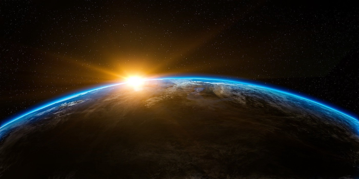 An image of sunrise on Earth, from space.
