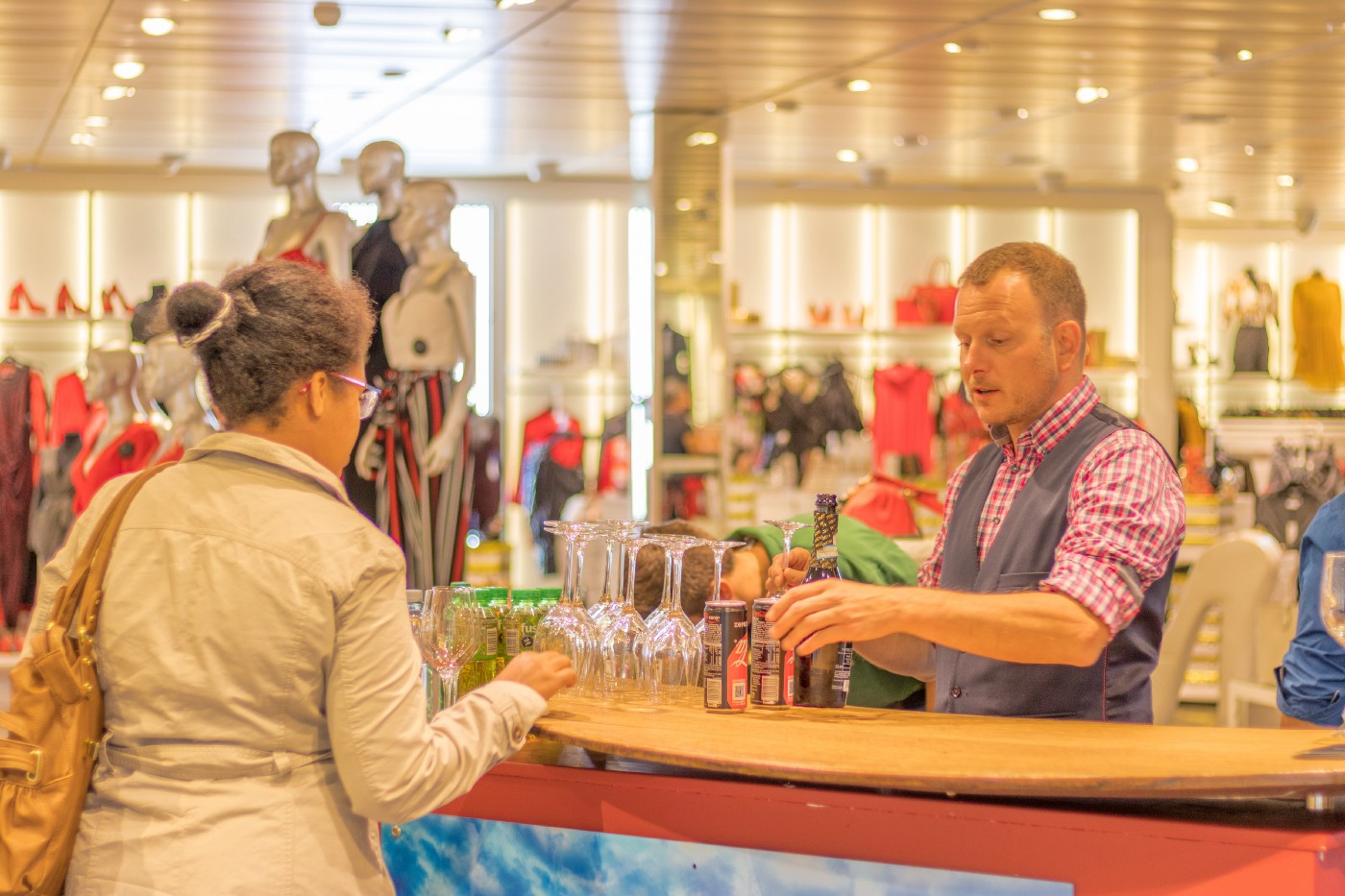 man sells beer at the department store
