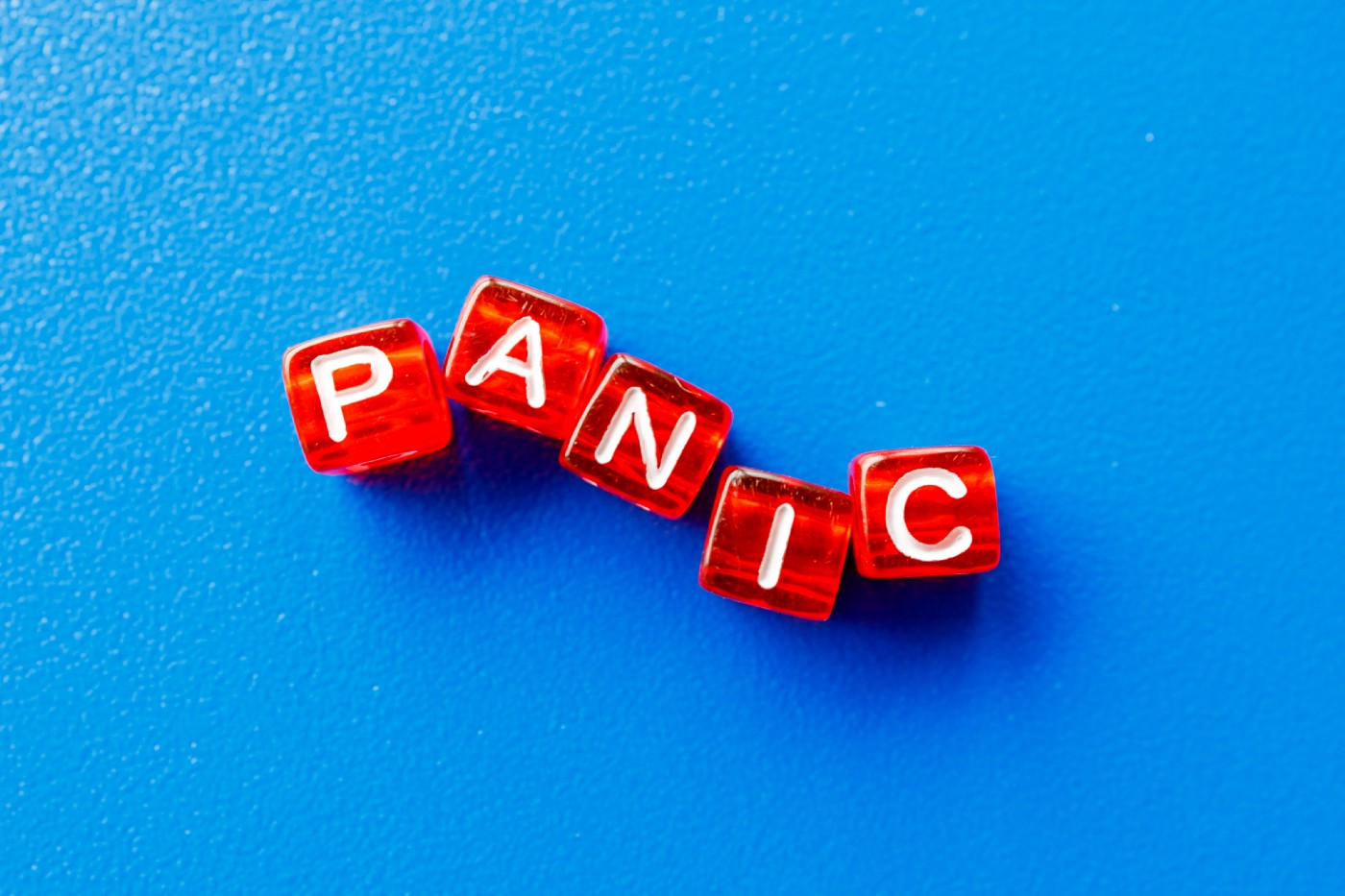Blue background with red and white letters that read the word panic