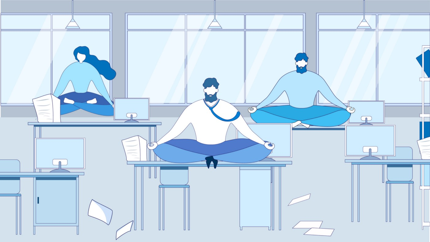 An illustration of cartoon office workers sitting on their office desks and meditating at their workplace.