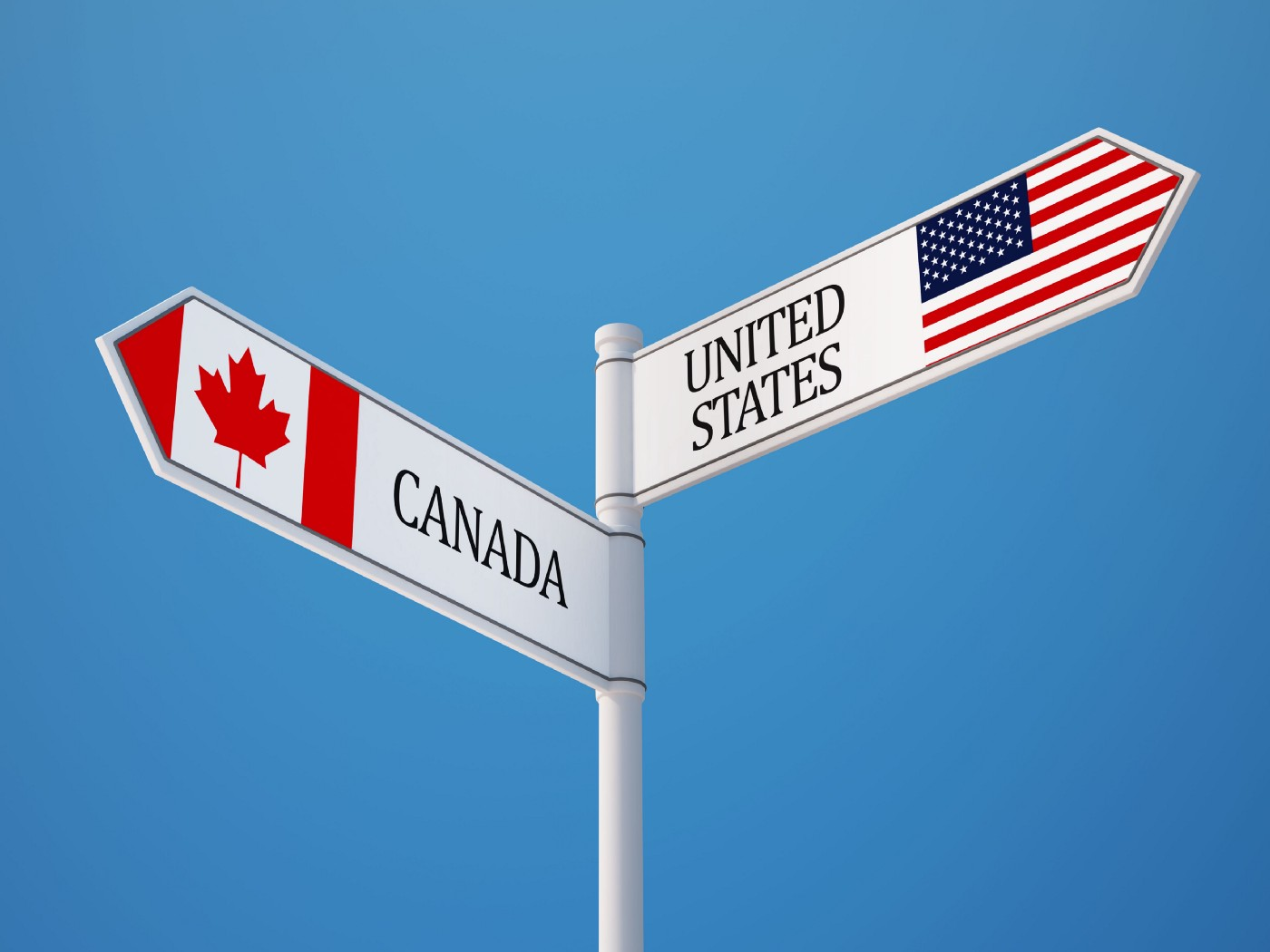 two signs, one directed at Canada, the other at the US