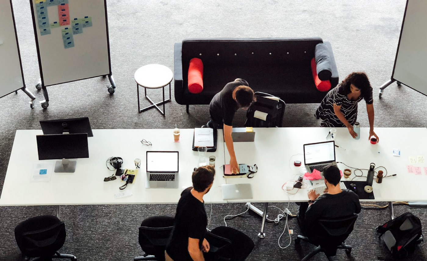 Bird-eye view photo of the Mentally Friendly team working on a project.