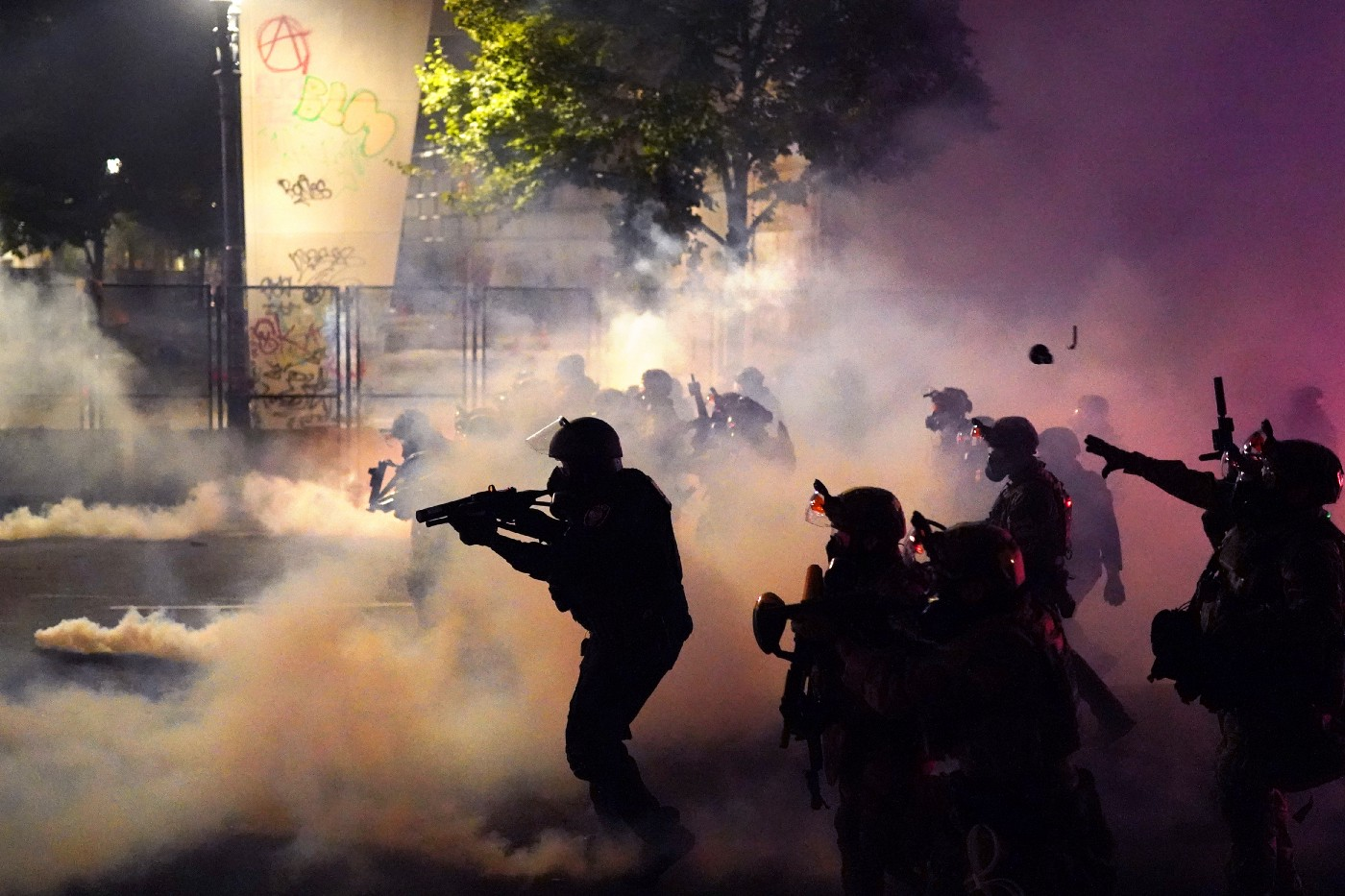 Federal officers deploy tear gas at protestors in front of the Mark O. Hatfield courthouse in Portland, Oregon.