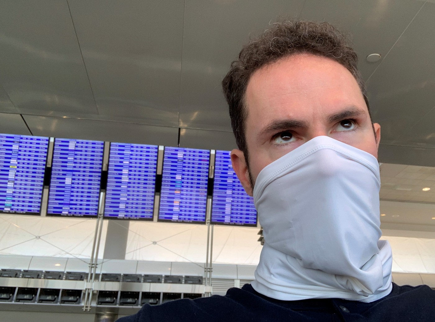 David Bookstaber in an airport wearing a mask