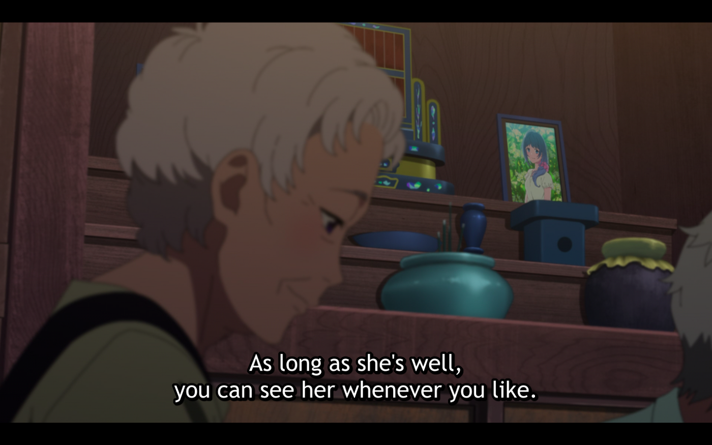 Kukuru's grandmother is telling Fuuka's mother that she will be able to see Fuuka as long as she is alive and well. In the background, there is a photo of Kukuru's deceased mother.
