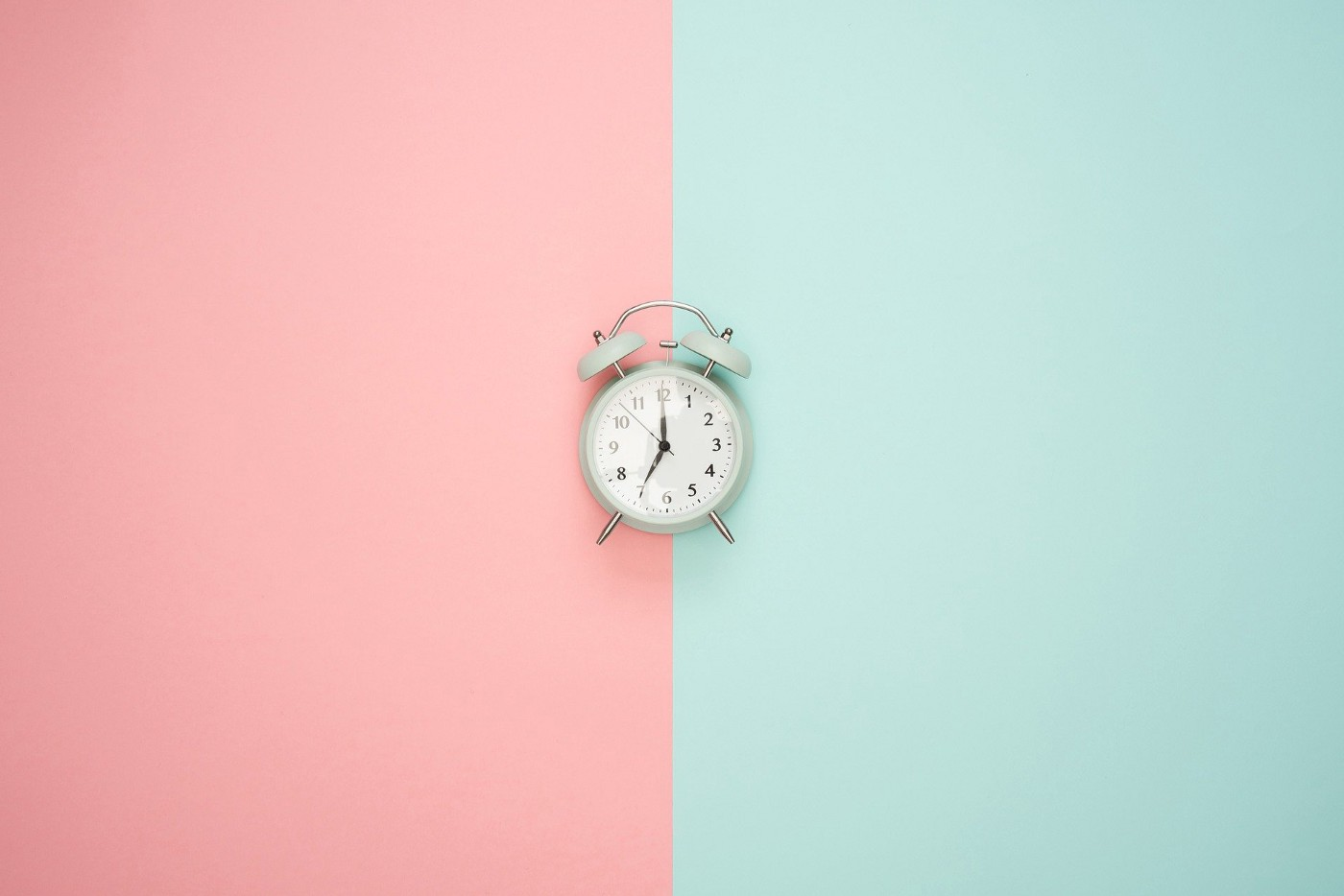 Clock on wall with two pastel colors.