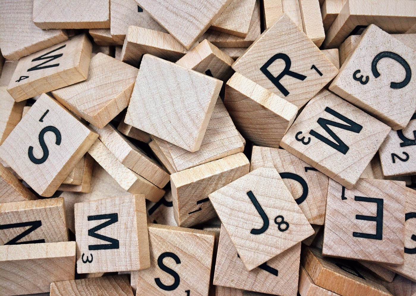 Wooden tiles with letters printed on them.