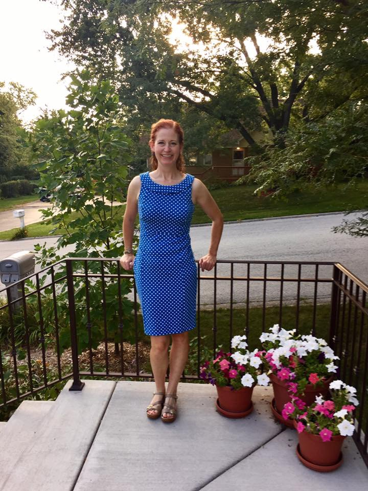Photo of author standing outside of her house.