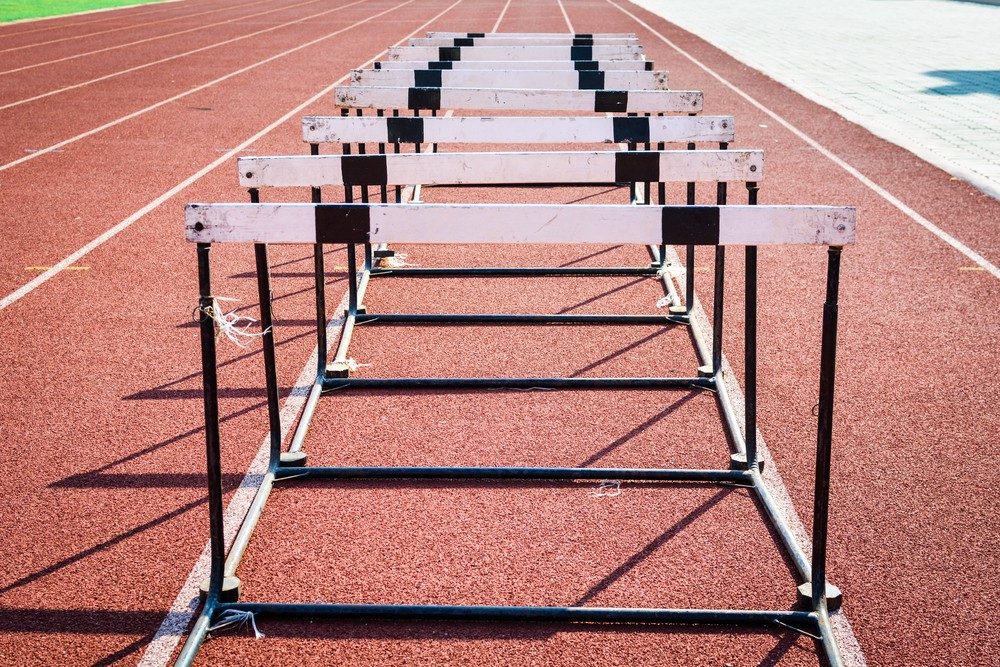 Hurdles lined up on a running track