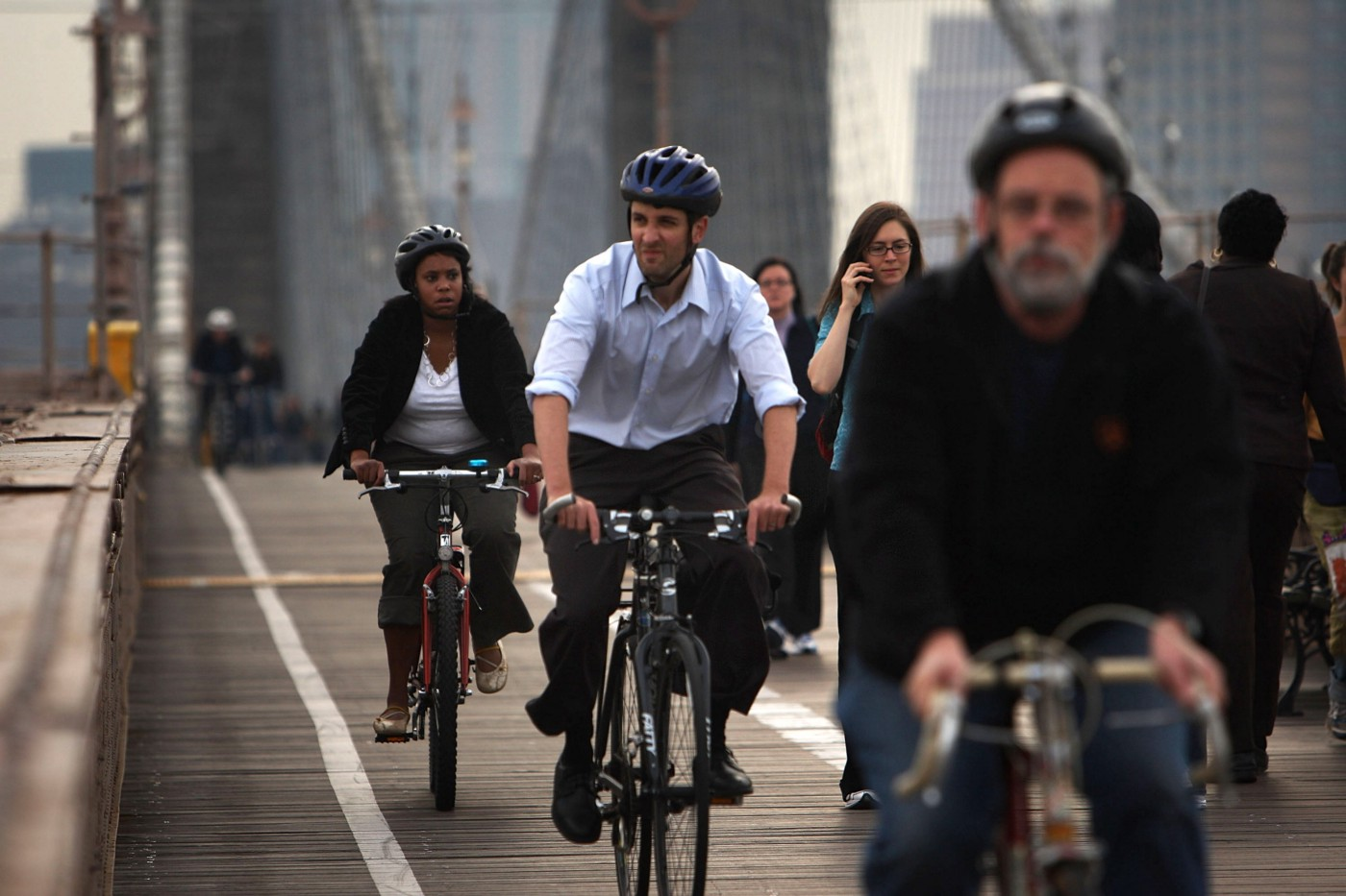 Bicycle commuters crossing the Brooklyn Bridge in New York City.