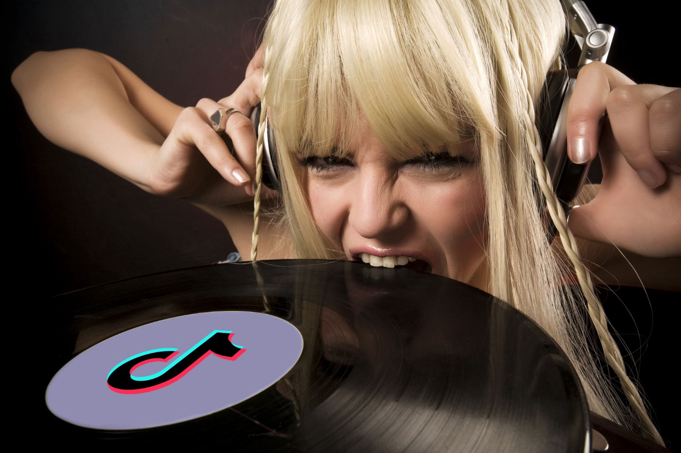 Lady listening to music while biting a vinyl record that has the TikTok logo on the top.
