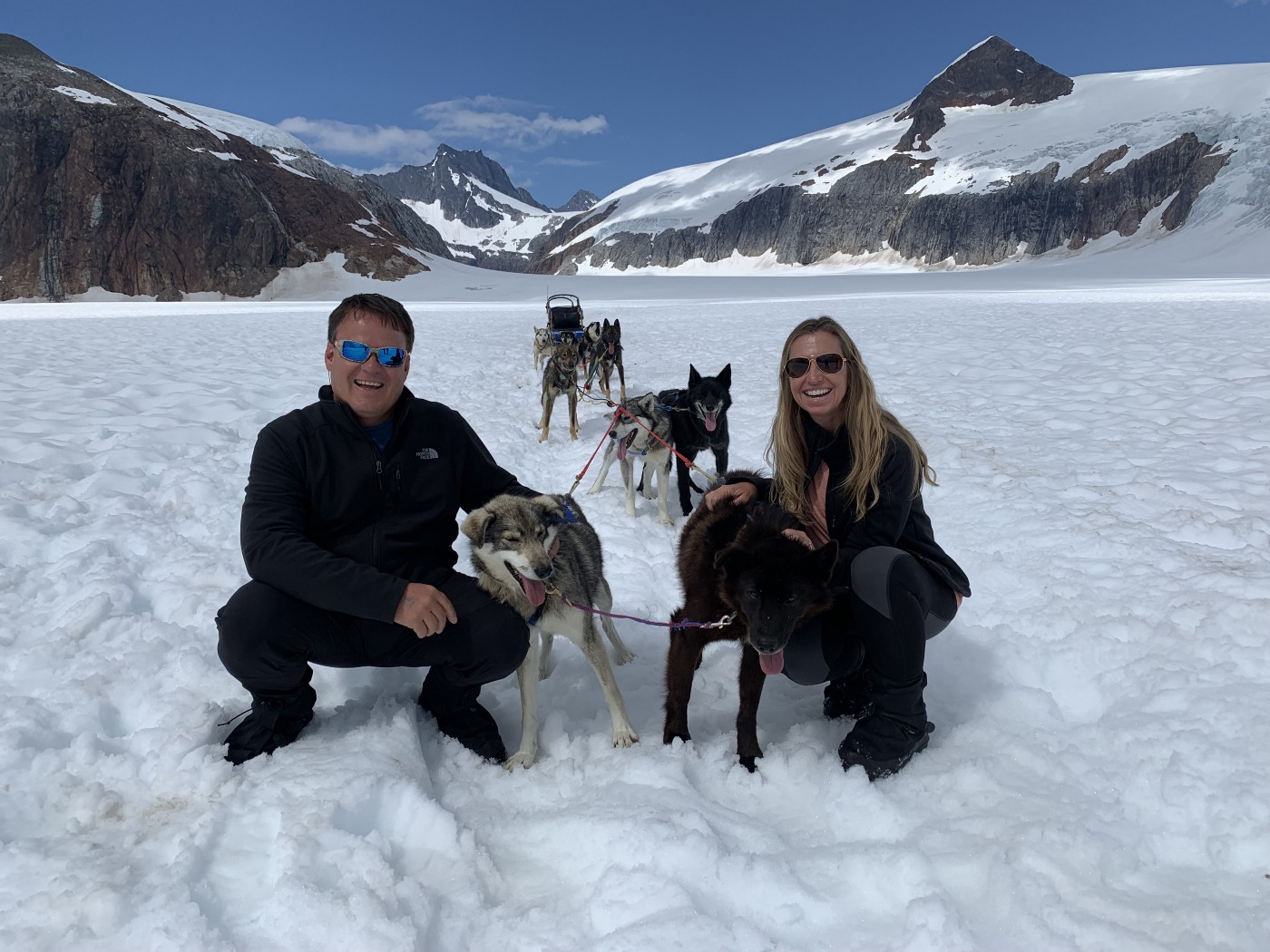 Lisa and Ronnie with sled dogs on Mendenhall Glacier in Juneau Alaska