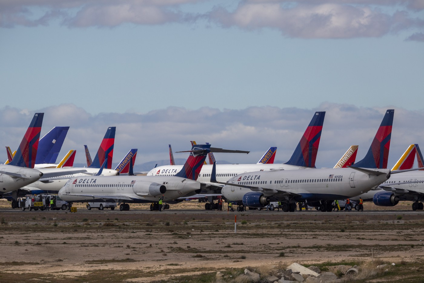 A fleet of Delta Airlines jets parked at the Southern California Logistics Airport (SCLA) due to decreased air travel.