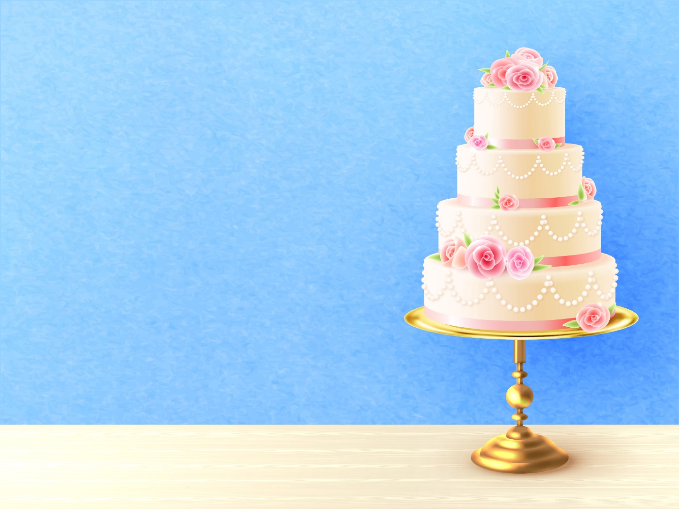 A white tiered cake with pink floral accents