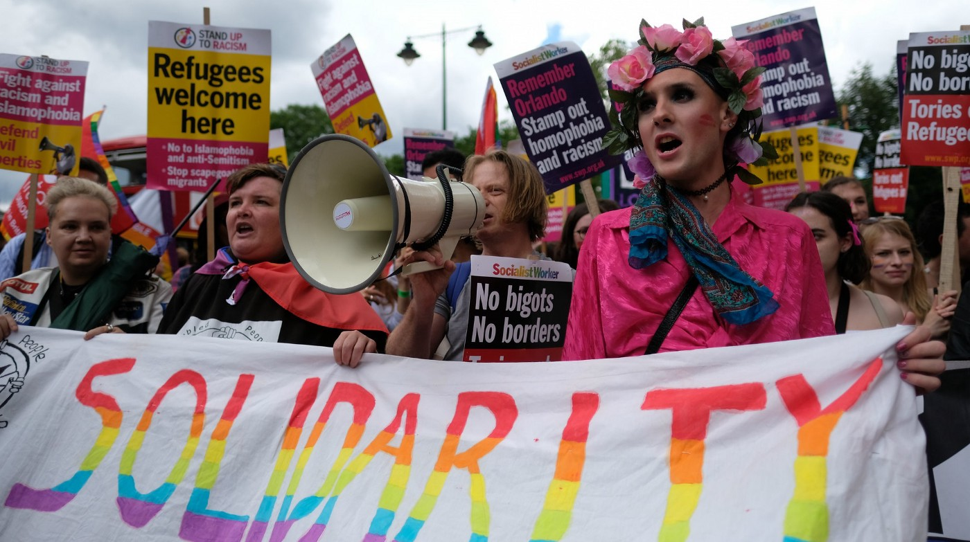 LGBTQ protest, with the banner 'Solidarity'.