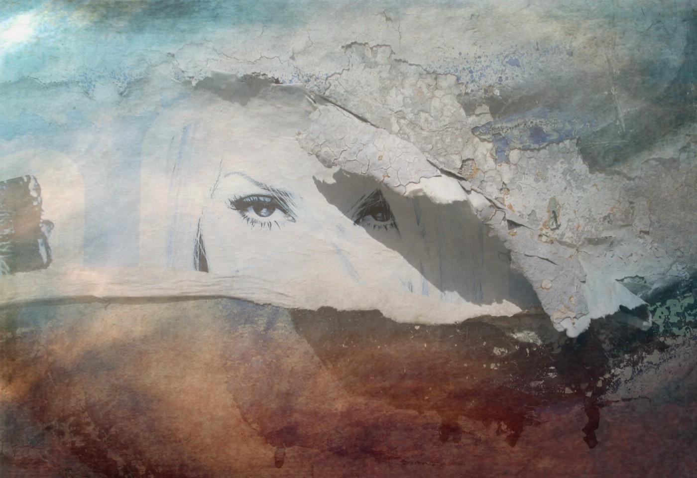 A photo of a wall in Mexico with peeling paint, where a flier was mostly torn away, but a piece of it with part of a woman's eyes still remains.
