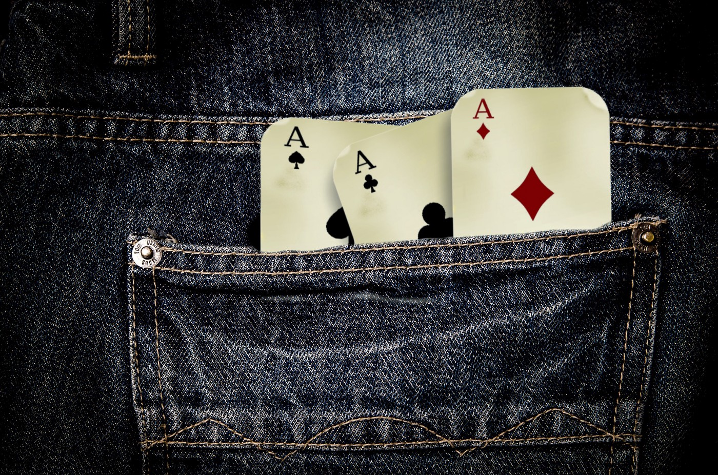 playing cards (aces) in jeans back pocket