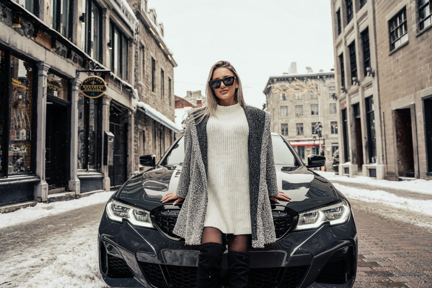 woman in front of car