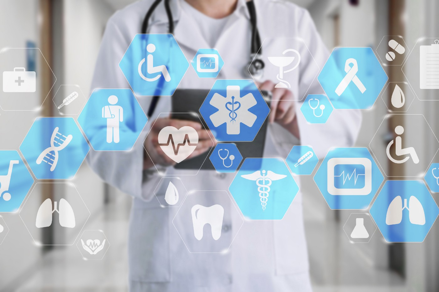 App icons floating with doctor holding a tablet