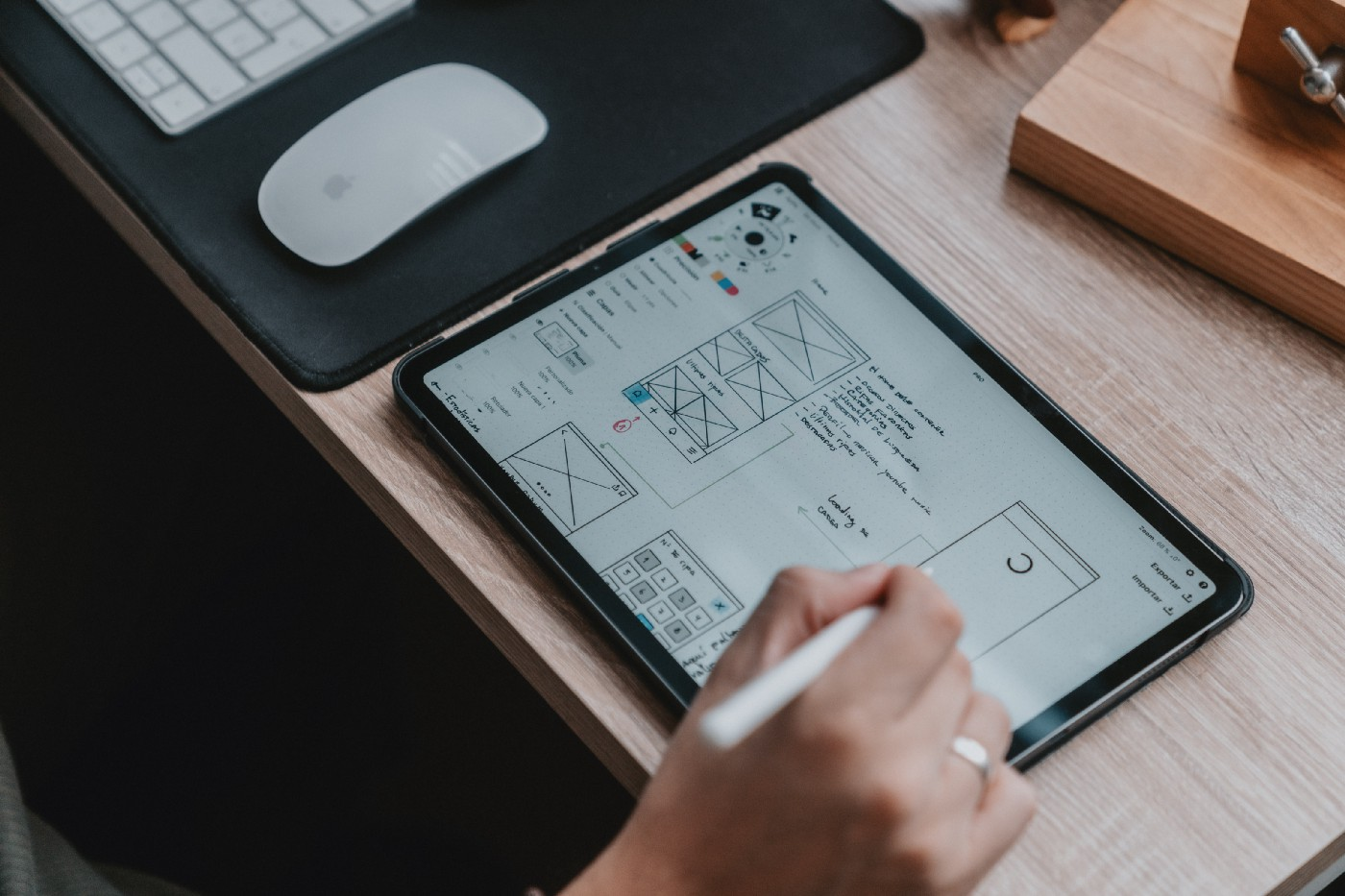 A designer working on UX design project on an I-pad