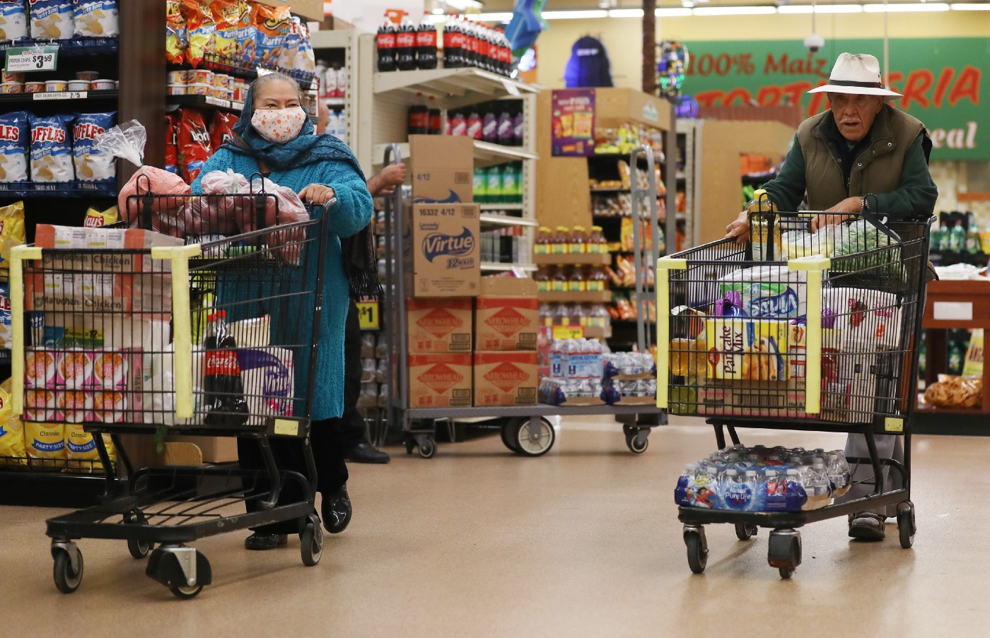Seniors shop for groceries at Northgate Gonzalez Market in Los Angeles during special hours open to seniors and the disabled.