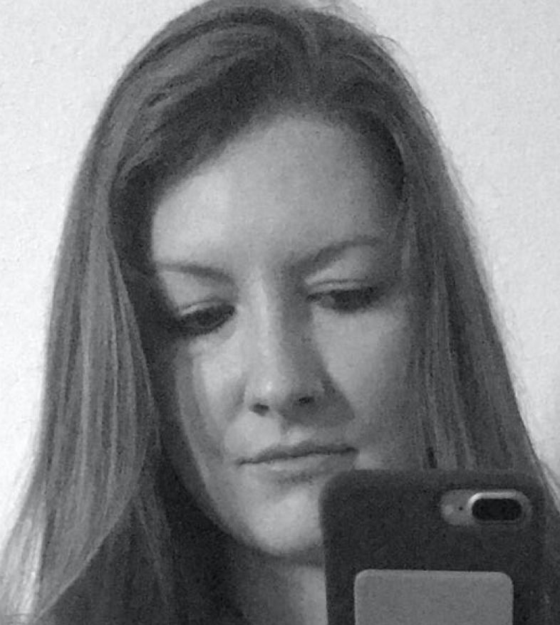 Black and white photo of myself taking a picture into a mirror with no smile.