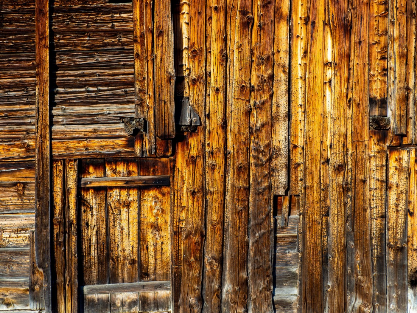 Rustic wooden door, nearly indistinguishable from planks of wood