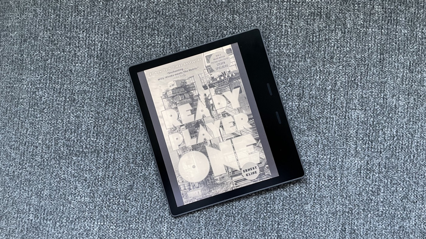 Kindle Oasis on a fabric background.