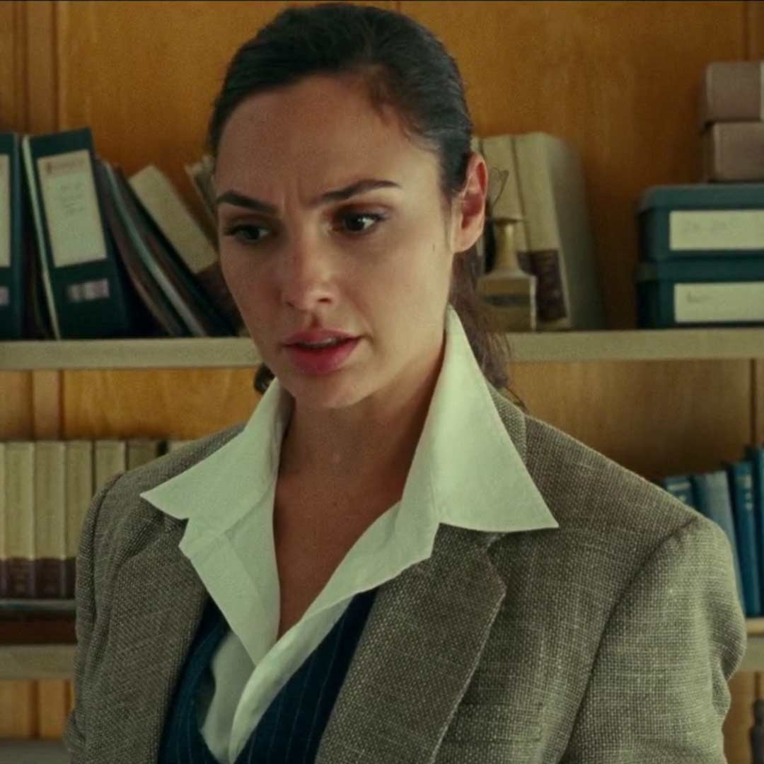Close up of Diana Prince looking concerned and confused.