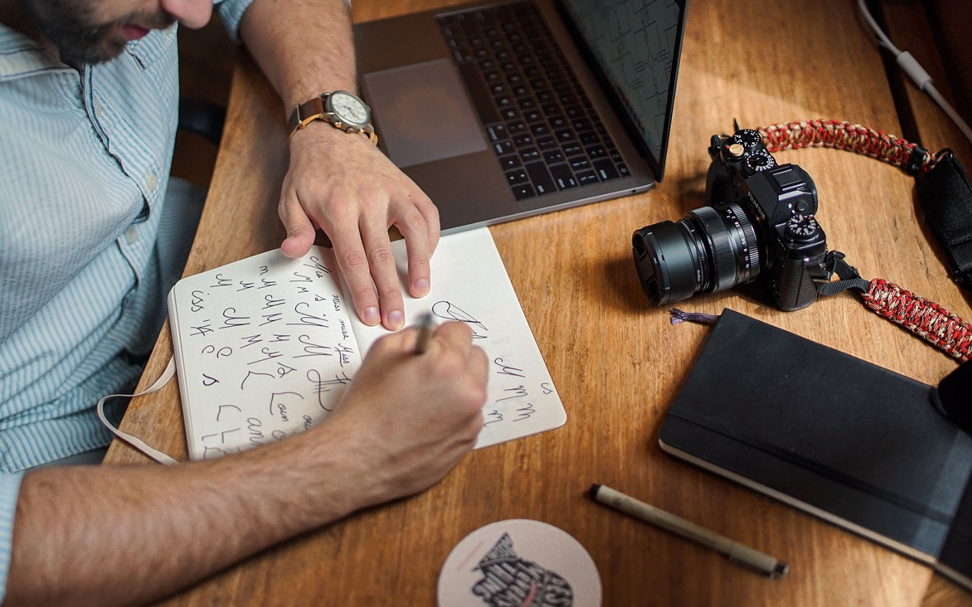 Man sketching design ideas in a notebook