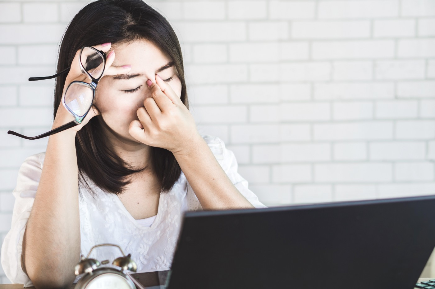 A woman showing discomfort from digital eye strain