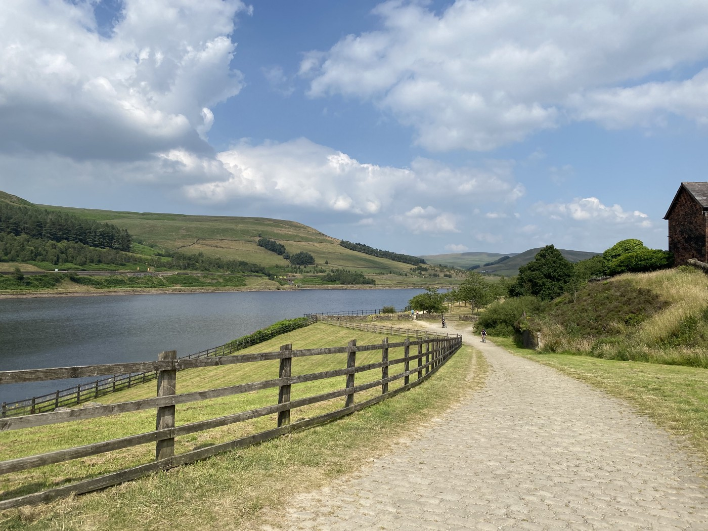 Wide cobbled bridleway above a reservoir on the Trans-Pennine Trail