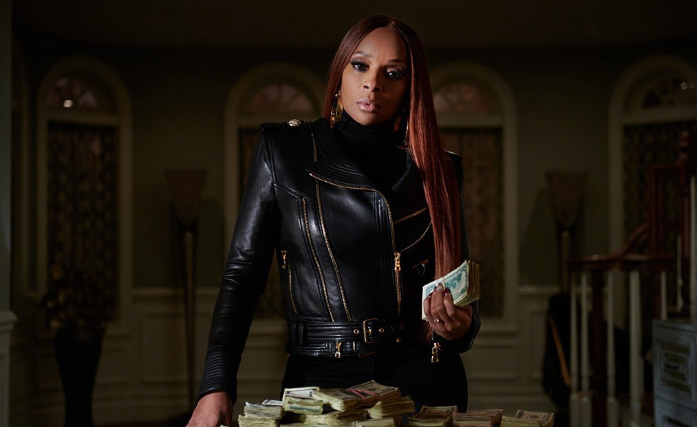 Mary J. Blige holding wads of bills. Credit: Power Book II Ghost / Starz
