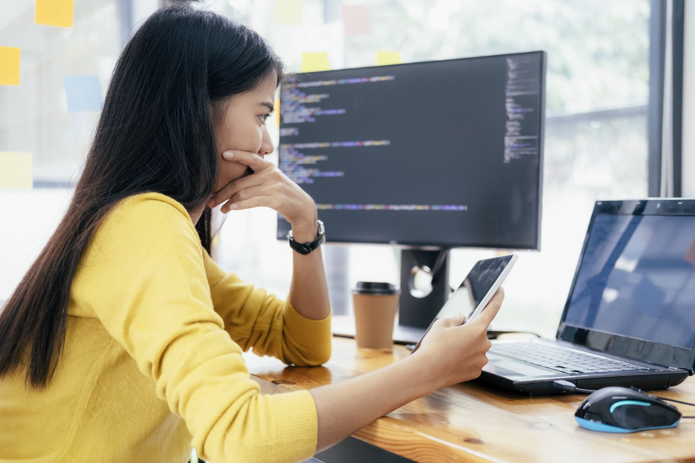 A woman looks at her laptop deep in thought, looking at the results of a business experiment.
