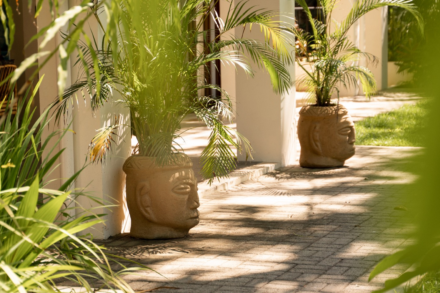 Locally made carved stone planters welcome guests at Hona Wellness in Dominical, Costa Rica. Project by New Utopia.