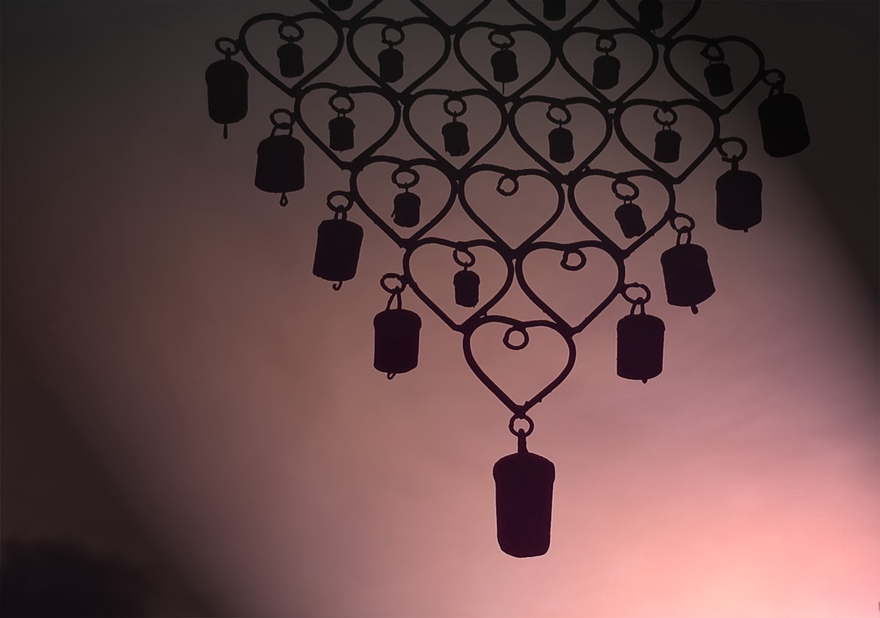 Wind chimes in a pink sky