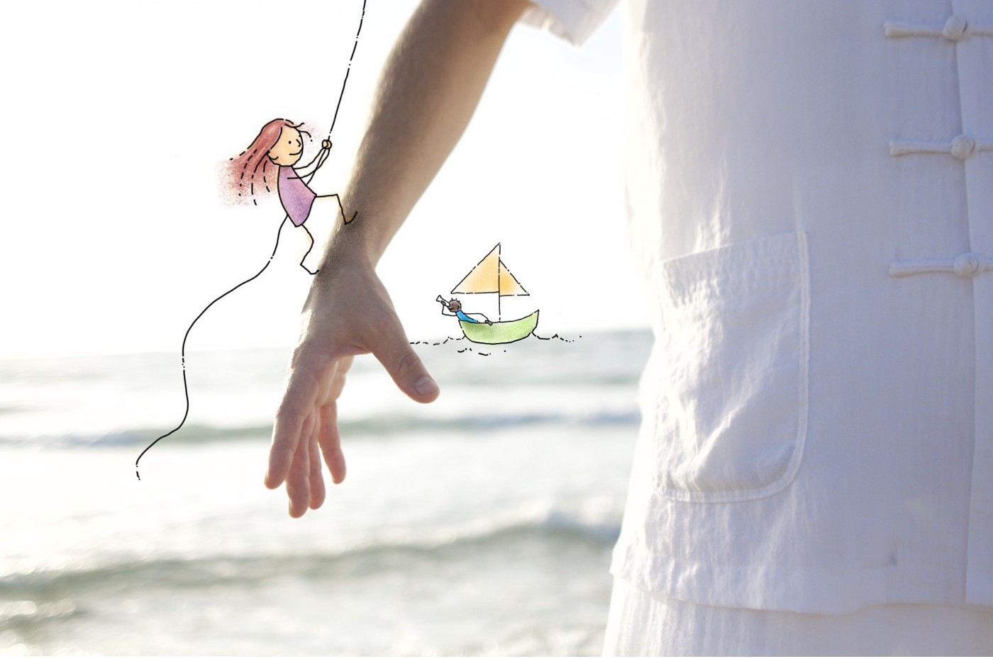Cropped photo of someone doing Tai Chi at the beach, with a cartoon person climbing up their arm and a cartoon person in a boat in the background.