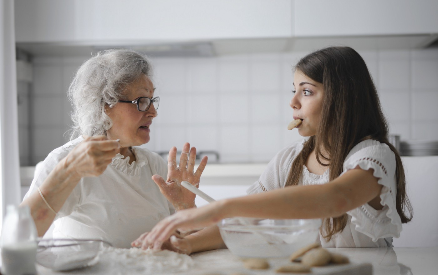 An old and young woman having a conversation in the kitchen