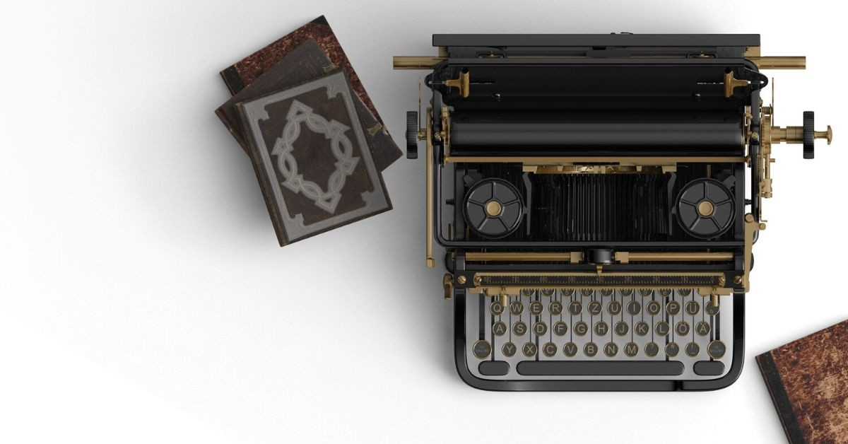 An antique typewriter and small stack of leather bound books