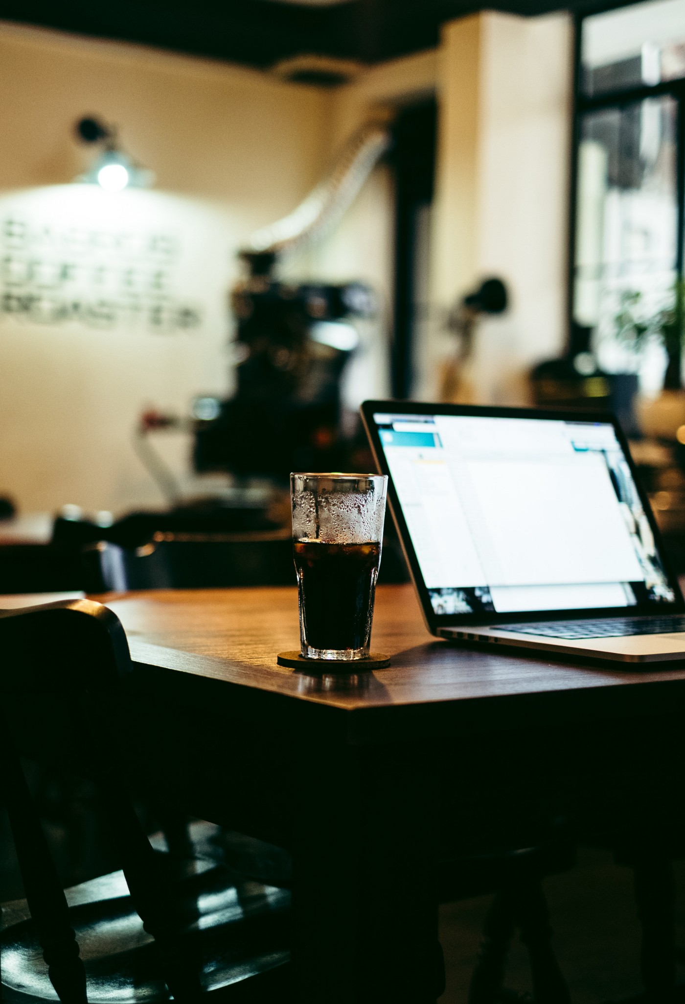 A laptop and a hot beverage on a table