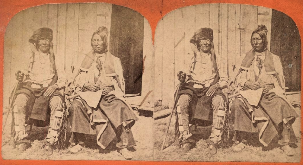 A stereo photograph of two chiefs of the Yankton Sioux, Dakota Territory, from about 1870: Strikes the Ree and Feather in the Ear.