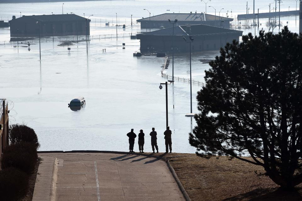 Floodwaters swallowed at least 30 buildings at Offutt Air Force Base, home of U.S. Strategic Command.