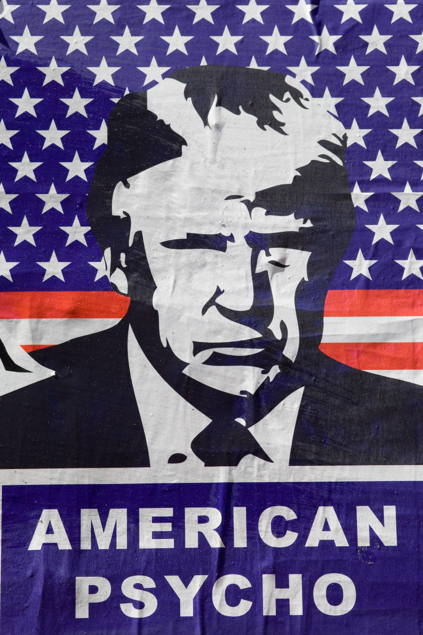 """Cartoon image of Donald Trump in front of the American flag, with the caption """"American Psycho""""."""