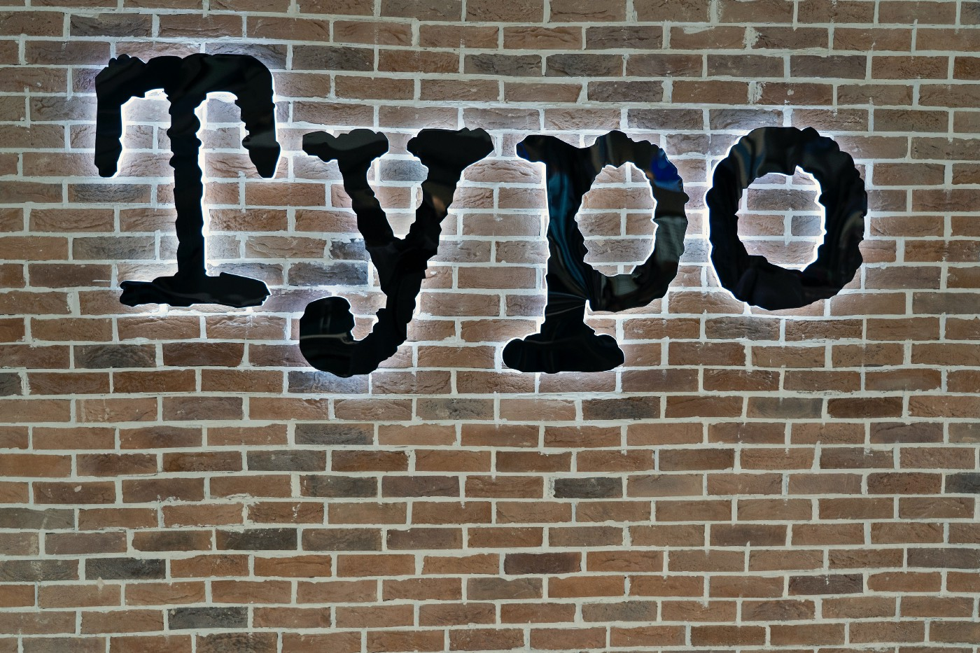 The word typo written on a brick wall