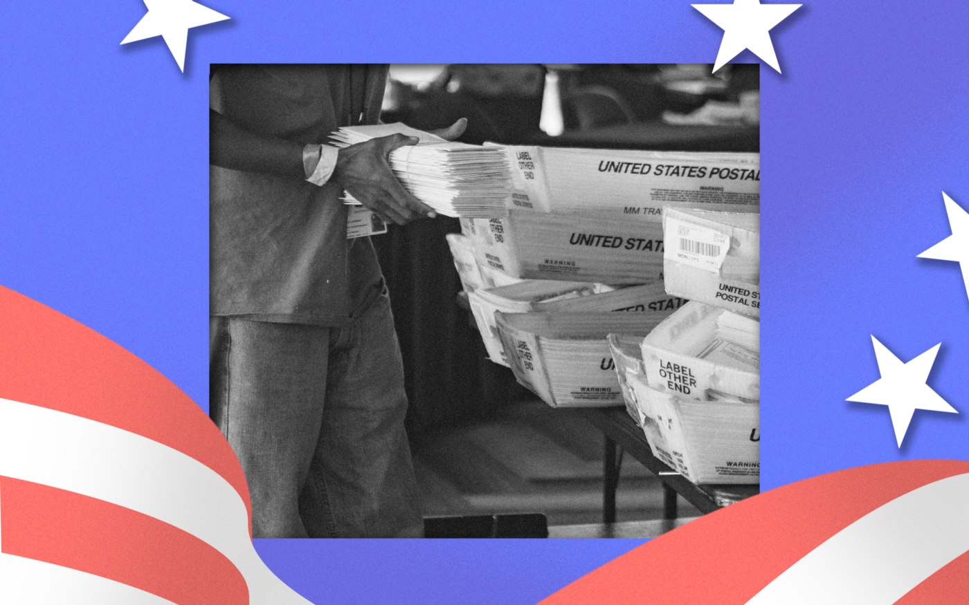 A poll worker collects mail-in ballots.