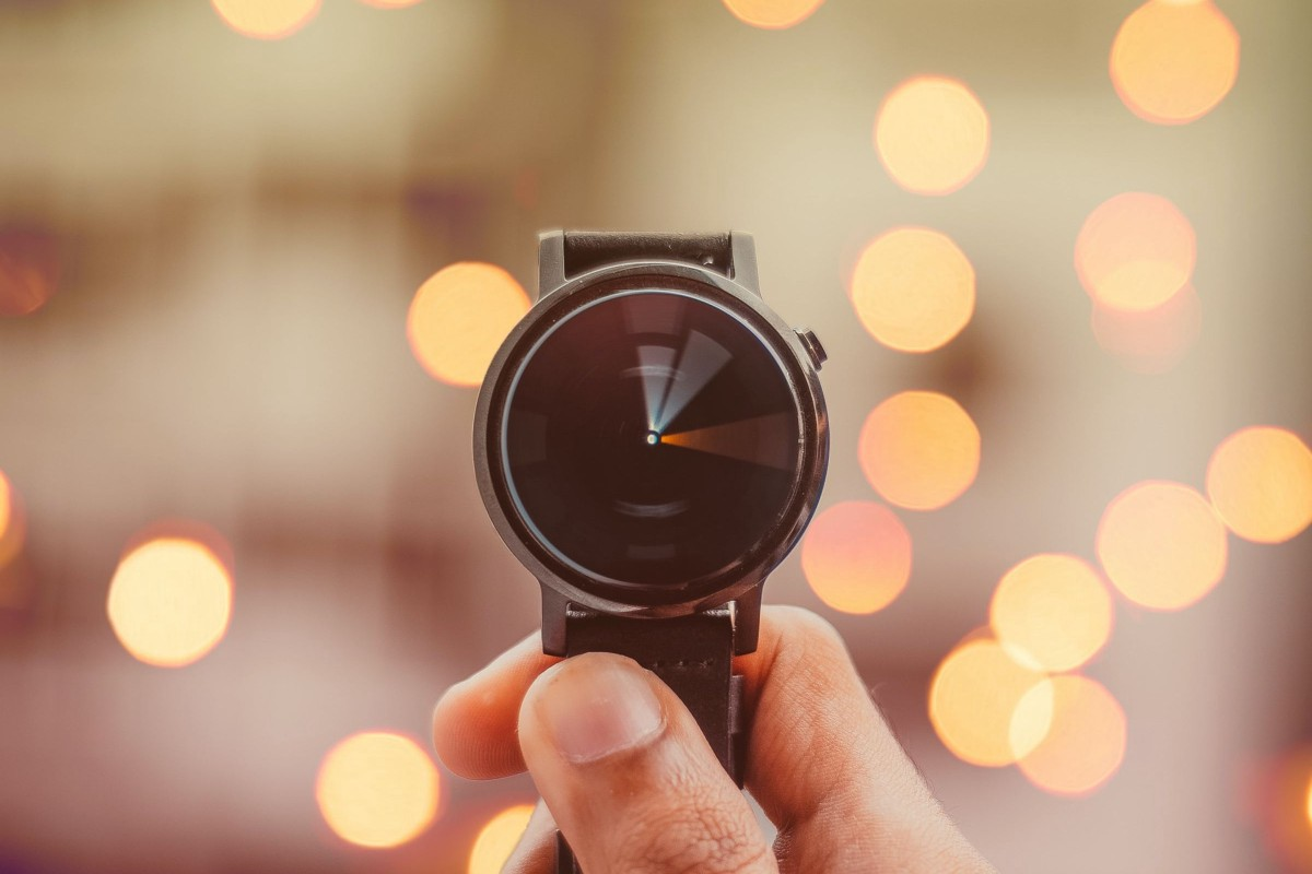 A watch in front of lights